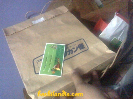 recycled paper bag as gift wrap